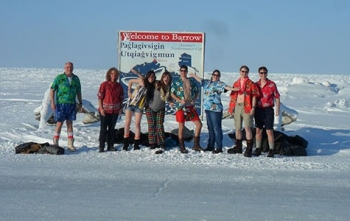 Student researchers wear Hawaiian-themed clothes in the snow.
