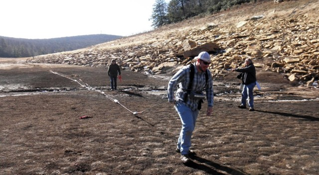 Ben Perdue dragging the OhmMapper array under Dr. Herman's watchful eye as part of subsurface resistivity survey.