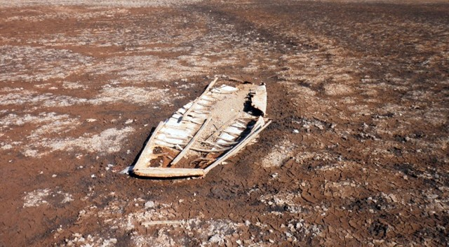 One of two sunken boats, exposed by the receding lake water.