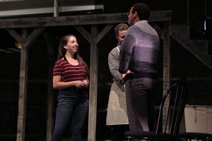 Director Megan Ward works with cast and crew members during a rehearsal of The Laramie Project