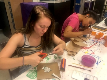 Students in Professor Lou Ann Thompson's class develop art education projects for varying age ranges.