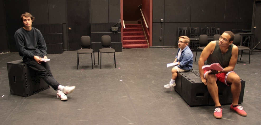 "Students pause for a break during an early rehearsal session for ""Darkside."""