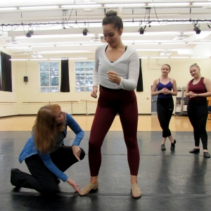 "Associate Professor Amy Vankirk works with a student during a ""Fall Dance Fest"" rehearsal."