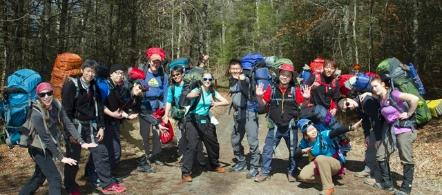 Students with backpacks on RU Outdoors trip