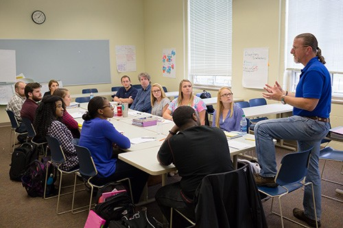 Clinical Mental Health Counseling master's students participate in a class discussion