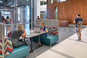Radford University English graduate students socializing in the brand new CHBS building, home of the English department