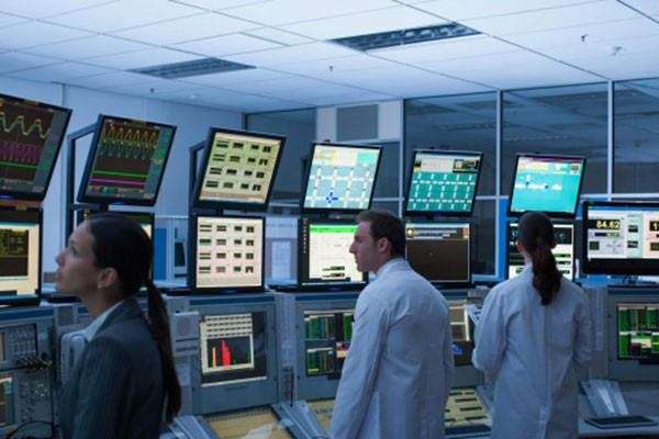 Employees in a computer control room
