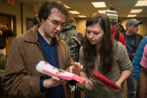 Students design and print prosthetic hands.
