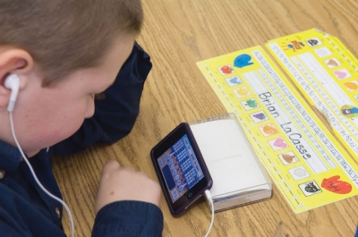 student using an iPod touch for a reading lesson