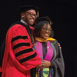 President Hemphill poses with a graduating student at Radford University's Winter Commencement 2017