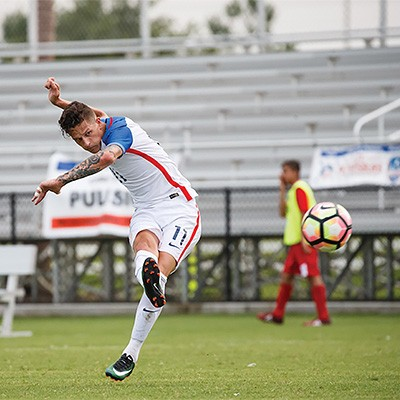 Radford University men's soccer junior Nick Mayhugh kicks the ball during the United States Paralympic games