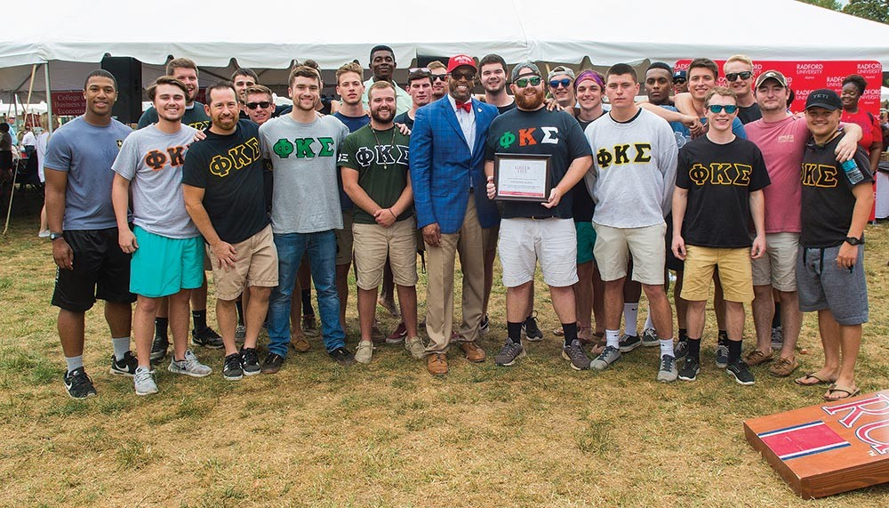 Phi Kappa Sigma fraternity accepting the 2017 Greek Life Challenge award.