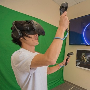 Radford University students explore a virtual world at the virtual reality lab