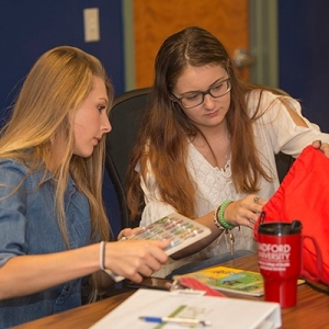 Students from Waldron College of Health and Human Services work on drawstring bags for needy children as part of the SPROUT Program in the New River Valley.