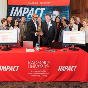 President Hemphill and former Governor Terry McAuliffe mark the beginning of the IMPACT program.