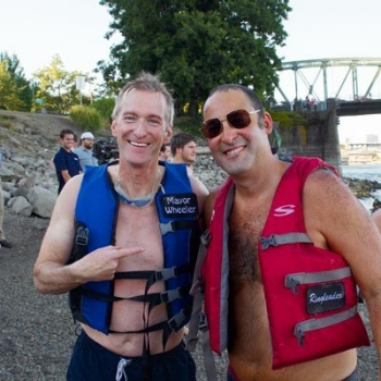 Willie Levenson '93 with Portland's mayor, Ted Wheeler, at the Big Float.