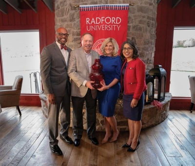 President Brian O. Hemphill, Ph.D., and First Lady Marisela Rosas Hemphill, Ph.D., honor the first recipient of The Spirit of the Tartan Award, Tom McGlothlin, joined by his wife, Sandy McGlothlin.