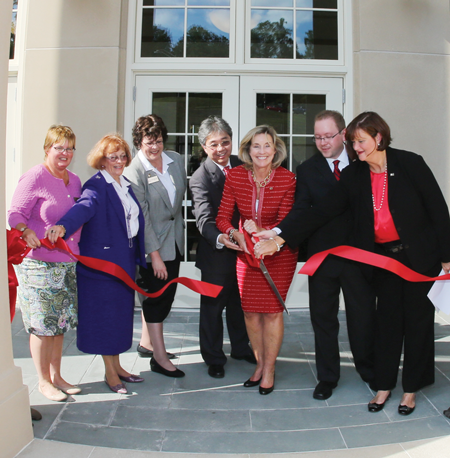 President Kyle and others at the ribbon cutting
