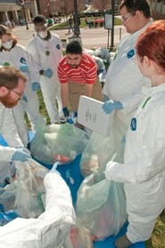 Volunteers in Tyvek suits