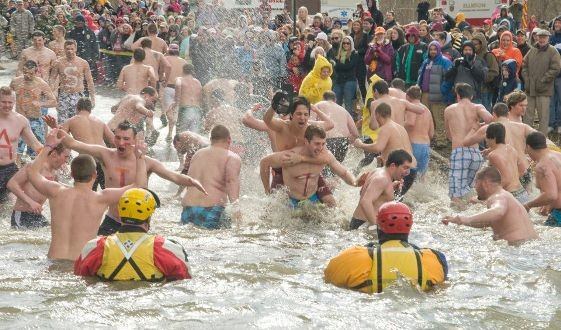 The brothers of Phi Sigma Kappa fraternity brave the icy waters of the New River