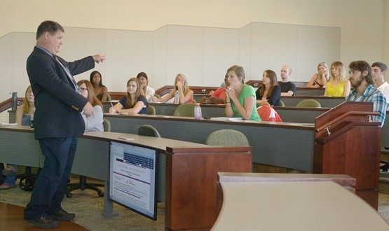 Dale Henderson, chair of the Department of Management, teaches his first class in the new COBE building Monday morning. one of the new classrooms in COBE