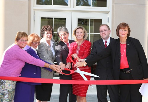 President Penelope Kyle and guests at the COBE ribbon cutting ceremony.