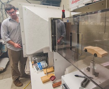 Using the wind tunnel in Curie Hall, Brian Uthe has developed a research project testing the flow dynamics of dimpled car bodies.