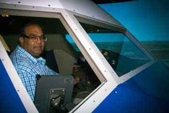RU Master's Candidate Muhammad Khan in the NASA Langley Research Center's 757 flight simulator