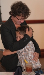 Walker, DNP embraces son at ceremony