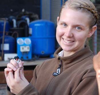 Laken Ciooper holds a house sparrow during her recent research expedition in Kenya