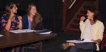 Lucinda McDermott talks with two students in her directors and playwrights class.