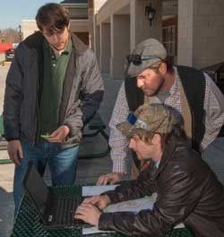 Volunteers monitor GIS Day date collection flow