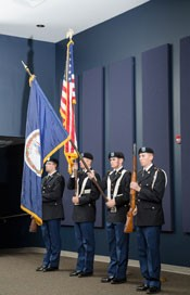 Army ROTC Cadets Chris DeMasi, Steven Milazzo, Joseph Stacey and Alexander Polk present the colors during the Veterans Day Ceremony in the Bonnie Auditorium
