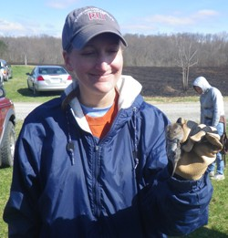 Karen Powers, associate professor of biology and RUTWS chapter adviser, handling a vole.