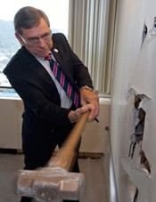 RU BOV Rector Wray swings to start demolition of walls that will soon be VIAL anatomy lab