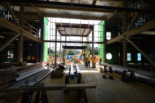 Work proceeds on the entrance of the College of Humanites and Behavioral Sciences Building