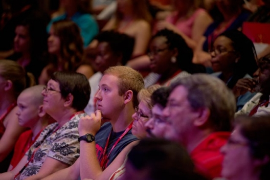 Transfer students, friends and family listen during the opening session of 2015 Transfer Quest