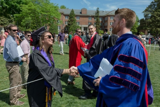 ESPN's Marty Smith '98 greets a proud Spring 2015 graduate.