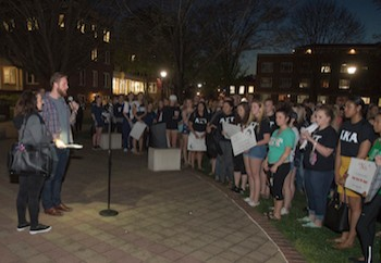 Keynote speaker Tim Mousseau addresses students during the Take back the Night march