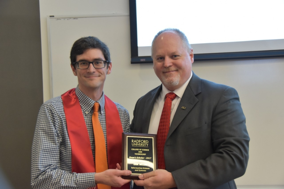 Erik Miller (left) is awarded the 2017 Dean's Scholar honor of Department of Information Technology Chair Jeff Pittges.