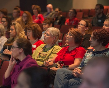 Classified Staff listen to President Hemphill during the Presidential Open Forums.