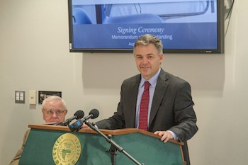 Chris Wade speaks at the signing of the Guaranteed Transfer Partnership Agreement on Aug. 28.