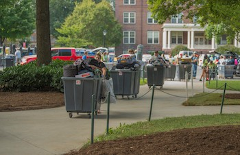 Volunteers help incoming students as they move into Muse Hall on Thursday morning at Radford University.