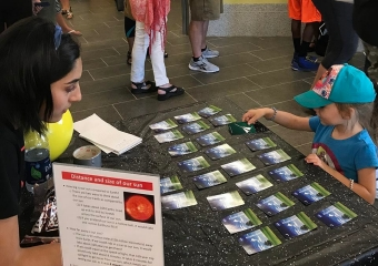 Sarah Garza (left) and Hailey Burnett (right) play a NASA-themed match game.