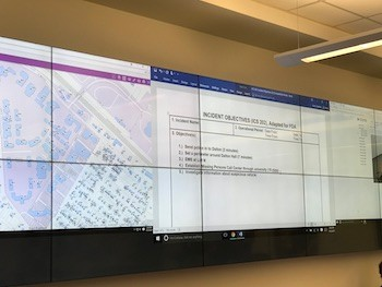Screens line the walls of the Emergency Operations Center