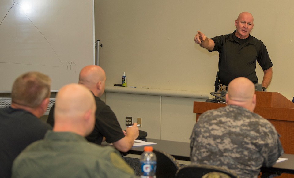 RUPD officers listen as they receive ALERRT training, which took place in Cook Hall and other locations across campus.