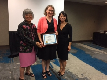 Radford University Assistant Professor of Chemistry Amy Balija (center) received the Centennial Award for Excellence in Undergraduate Teaching at the Iota Sigma Pi Triennial Convention in Indianapolis, Indiana