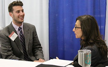 Radford University student Ben Siegel speaks with a recruiter at the Education Career Fair on March 17.