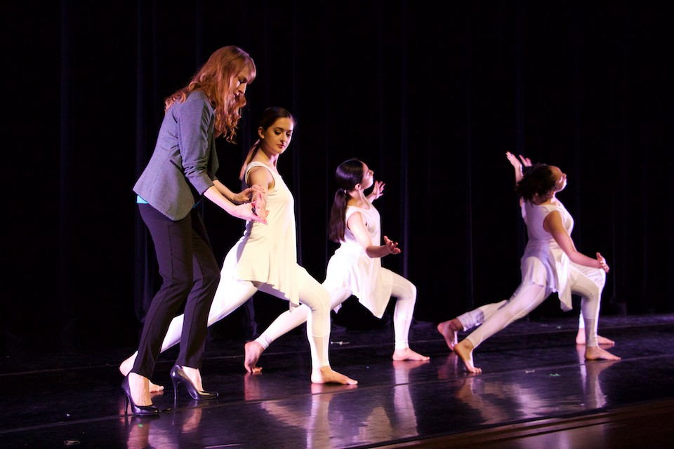 Assistant Professor of Dance Amy VanKirk instructs her dancers during rehearsal.