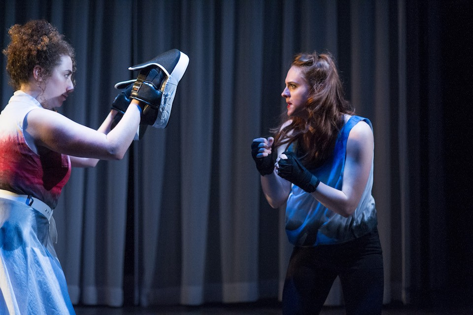 "Desdemona, portrayed by Kelsey Godfrey, right, practices boxing in one of the contemporary scenes in ""Othello."""